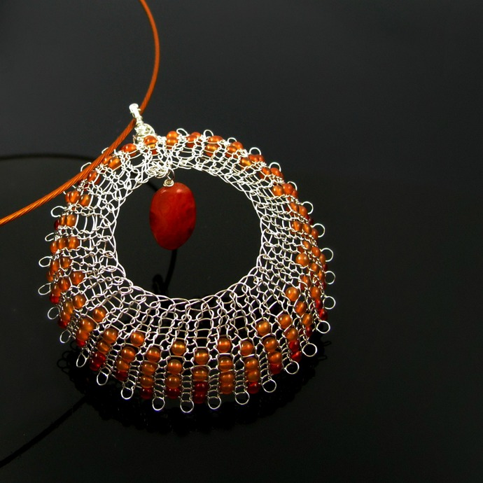 Fine silver wire knit web pendant with red and orange carnelian beads