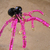 Spooky spider bracelet in brass, pink, and black. Arachnid Halloween jewelry