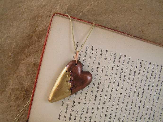 Steampunk broken heart pendant in copper and gold with purple stitches