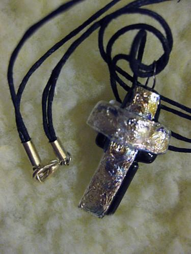 Dichroic cross in silver outlined in black glass on jute chain