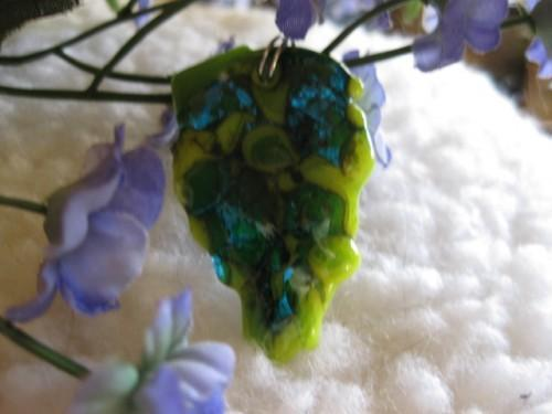 Fused glass shades of green and blue hand formed into a leaf