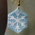 Snowflake On Pale Blue Background