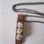 Porcelain jasper square beads wrapped with copper wire on copper plate, jasper