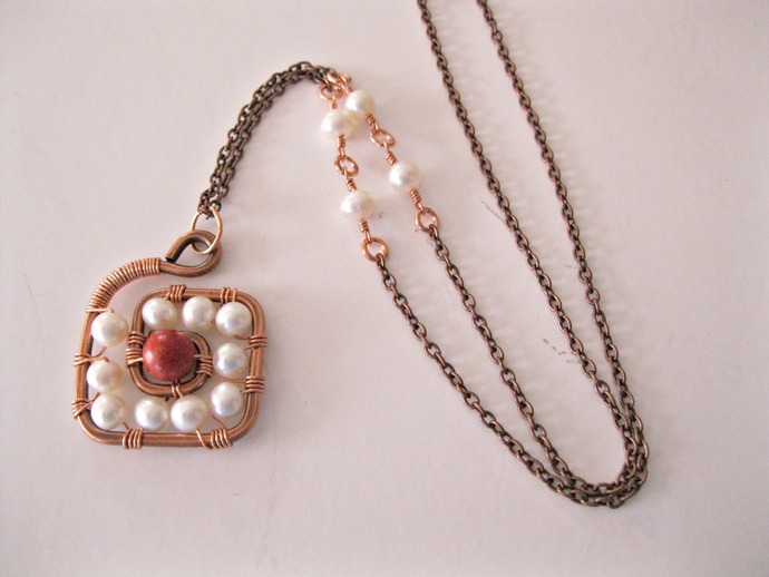 Copper spiral pendant wire wrapped with pearls and sponge coral, copper