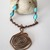 Hand formed copper wire flower with turquoise beads wire wrapped in copper wire