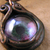 Purple and green dragon eye steampunk pendant with verdigris copper surround